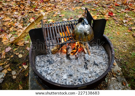 Kettle on the outdoors grill - stock photo