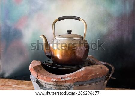 Kettle on the stove, Still life style - stock photo