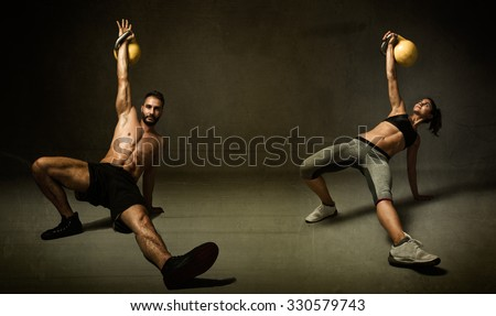 kettleball excercise for two persons, dark background - stock photo