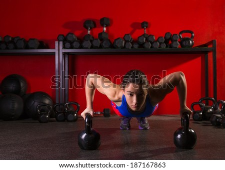 Kettlebells push-up woman strength pushup exercise workout at gym - stock photo
