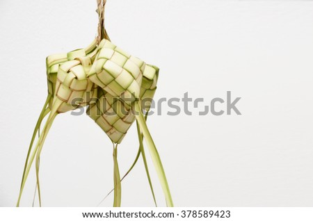 Ketupat on white background. Ketupat is traditional food in Malaysia ( retro version, out of focus at full reso ) - stock photo