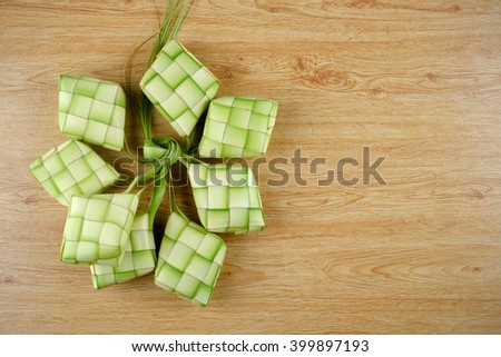 Ketupat  (rice dumpling) is a local delicacy during the festive season in South East Asia. Ketupat, a natural rice casing made from young coconut leaves for cooking rice. - stock photo