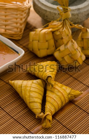 Ketupat: South East Asian rice cakes bundle, often prepared for festivities and celebratory occasions. - stock photo