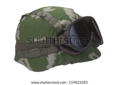 kevlar helmet with camouflage cover and protective goggles - stock photo