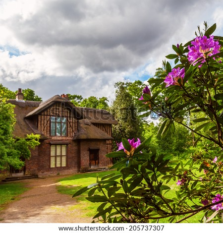 KEW, ENGLAND - MAY 22: Royal Botanical Garden on May 22, 2014 in Kew. Created 1759 it is one of the oldest Botanical Gardens of the world with yearly between 1 and 2 Million visitors  - stock photo