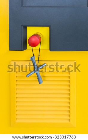Key and emergency button on the cover of machine  - stock photo