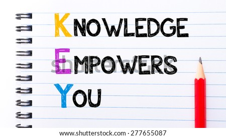 KEY as Knowledge Empowers You Text written on notebook page, red pencil on the right. Motivational Concept image - stock photo
