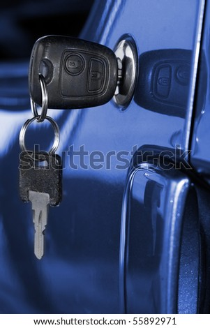 Key at car doors - close up with shallow DOF - stock photo