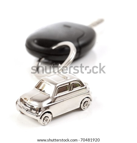 Key car with little key ring in car's shape - stock photo