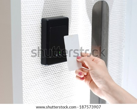 Key card with female hand - stock photo