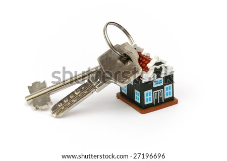 key chain in the form of a private house, two metal keys - stock photo