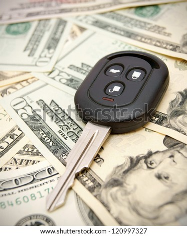 Key from the car on dollars. - stock photo
