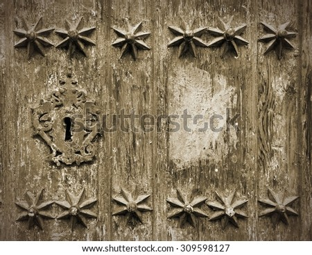 Key hole in vintage Valladolid cathedral door - stock photo