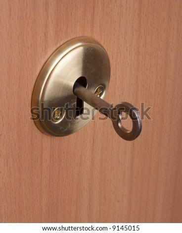 Key in a keyhole - stock photo