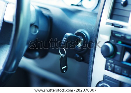 Key inserted into the lock of ignition of the car - stock photo