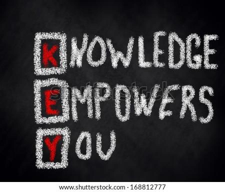 key knowledge empowers you chalk black board - stock photo