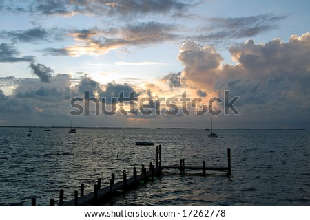 Key Largo sunset over dock - stock photo