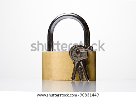 Key lock with a bunch of small keys - stock photo