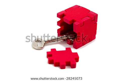 Key opens up a puzzle, isolated on white background - stock photo