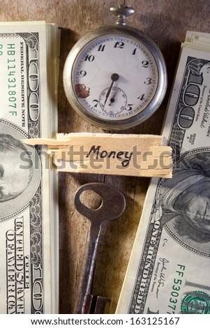 Key to Financial Success. Money, keys, pocket watch. - stock photo