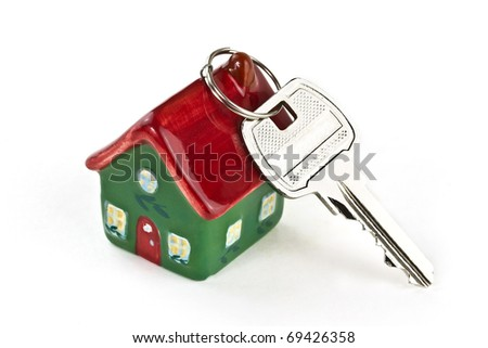 Key to new home isolated on white - stock photo