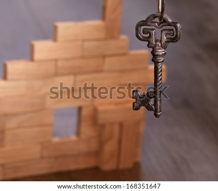 key to the toy house - stock photo