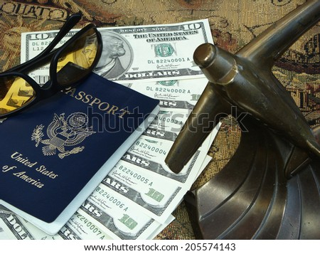 Key Travel Items. Don't forget your passport, sun glasses, mode of travel, a map, and of course money.  - stock photo