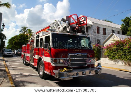 KEY WEST, FL - AUGUST 10: Key West's Fire Truck drives back to central after a false fire alarm. Soaring temperatures tr keep the fire brigade on high alert. August 10 2010, Key West, Florida. - stock photo