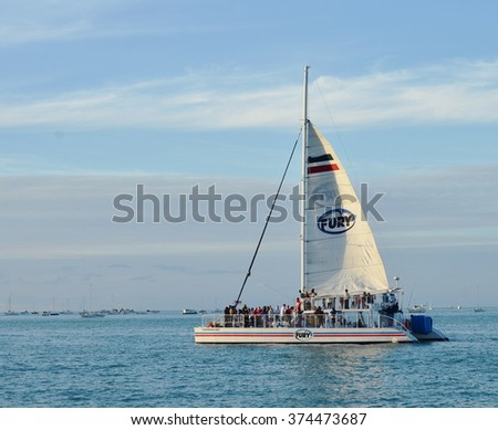 KEY WEST, FL.-FEBRUARY 8:  A Fury Charters catamaran takes tourists on a Sunset Cruise on February 8, 2016, in Key West, Florida. - stock photo