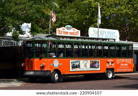 KEY WEST, FL-OCTOBER 1:  A Old Town Trolley Car awaits passengers in Key West, Fl. on October 1, 2014.  The Trolley is a popular attraction that takes tourists on a narrated tour of Key West. - stock photo