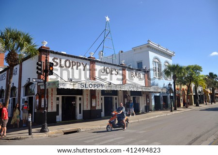 KEY WEST, FL, USA - DEC 20: Sloppy Joe's Bar on Duval Street on December 20th, 2015 in Key West, Florida, USA. Sloppy Joe's Bar is a historic bar in Key West and was Ernest Hemingway's favorite.  - stock photo