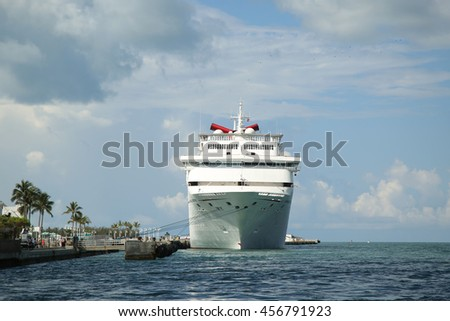 KEY WEST, FLORIDA - JUNE 1, 2016: Carnival Fantasy Cruise Ship anchors at the Port of Key West. Carnival Fantasy is the lead ship of the Fantasy-class of cruise ships operated by Carnival Cruise Line - stock photo