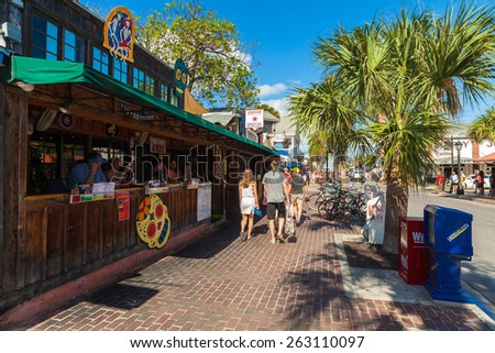 Key West, Florida USA - March 3, 2015: Popular restaurants and bars along Greene Street and Duval in downtown Key West. - stock photo