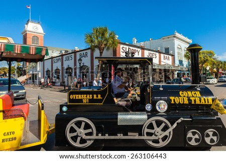Key West, Florida USA - March 3, 2015: The historic Sloppy Joe's Bar on Duval Street in downtown Key West with the Conch Train. - stock photo