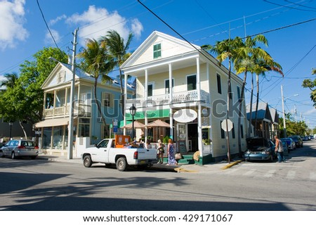 KEY WEST, FLORIDA, USA - MAY 01, 2016: Typical Florida houses in Duval street in the center of Key West - stock photo