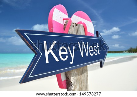 Key West sign on the beach - stock photo