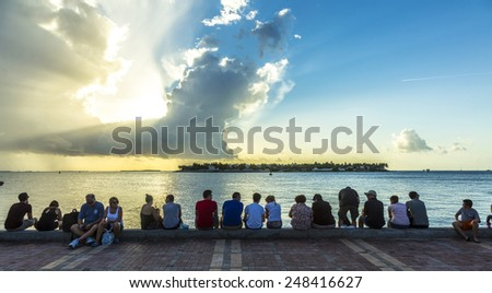 KEY WEST, USA - AUG 26, 2014: people enjoy the sunset point at Mallory square in Key West, USA. This place is the most popular sunset point in Key West. - stock photo