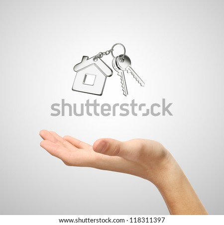 key with  key chain and hand - stock photo