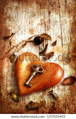 Key with the heart as a symbol of love/vintage card with red heart on grunge old background/valentines day background - stock photo