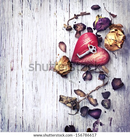 Key with the heart as a symbol of love/vintage card with red heart on grunge old background/ Valentines day background - stock photo
