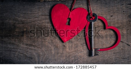 Key with the hearts as a symbol of love. Heart with a keyhole. Key of my heart concept. - stock photo
