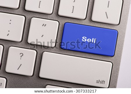 keyboard button with word sell - stock photo