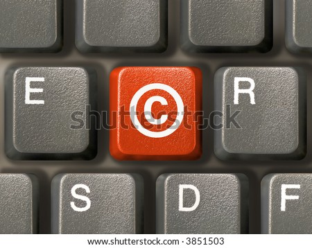 Keyboard (close-up), red key with Copyright symbol - stock photo
