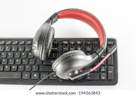 keyboard computer and headphone on a white background - stock photo