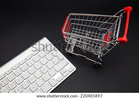 keyboard computer and shopping cart - stock photo