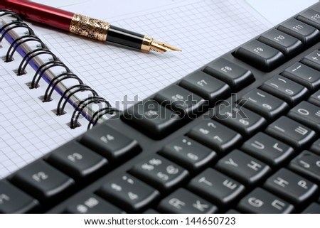 keyboard,note pad and classic gold fountain pen isolated on a white background - stock photo