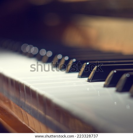 Keyboard of piano. Selective focus image. Warm color Music background - stock photo
