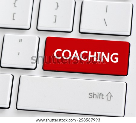 Keyboard with coaching button. Computer keyboard with coaching button - stock photo
