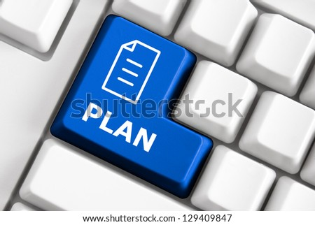 Keyboard with color button, business plan symbol and text - stock photo