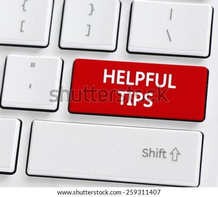 Keyboard with helpful tips buton. Computer keyboard with helpful tips button - stock photo